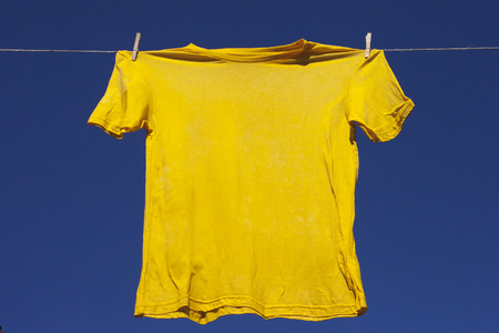 Drying of shirt on clothesline. Stock Photo