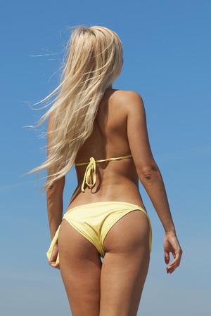 Blonde woman on the beach.