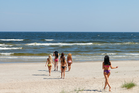 latvia girls: Young women on the beach.