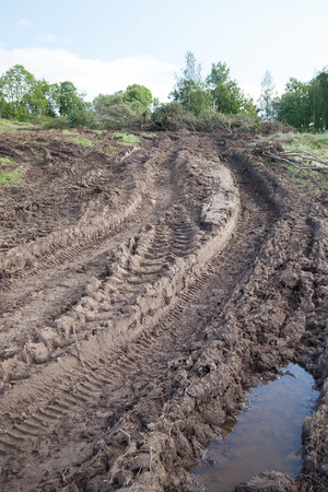 muddy: Tractor tire tracks in muddy soil. Stock Photo