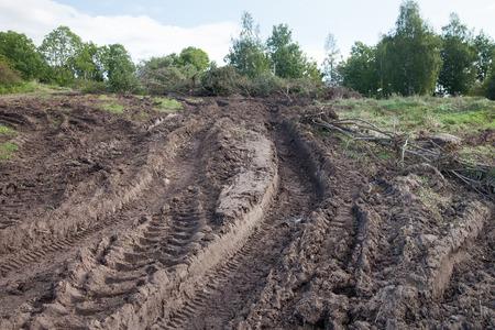 muddy tracks: Tractor tire tracks in muddy soil. Stock Photo