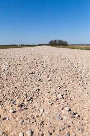 contryside: Gravel road in contryside. Stock Photo
