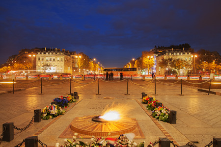 tomb of the unknown soldier: Eternal flame on the tomb of unknown soldier, place Charles de Gaulle, Paris, France.