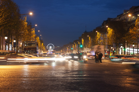 elysees: Evening time in avenue Champs Elysees,  Paris, France.
