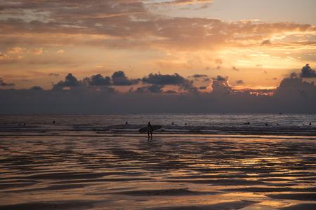 san sebastian: Bay of Biscay and surfers in sunset San Sebastian Spain. Stock Photo