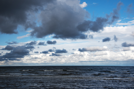 dark: Dark clouds over dark Baltic sea.