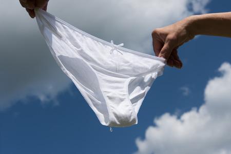 undies: Wet underwear against blue sky. Stock Photo