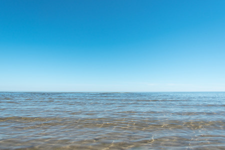 lull: Clear and  blue sky over gulf of Riga, Baltic sea.
