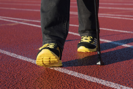 legs: Womans legs exercising walking in stadium. Stock Photo