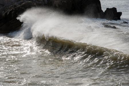 windy energy: Splashing atlantic wave. Stock Photo