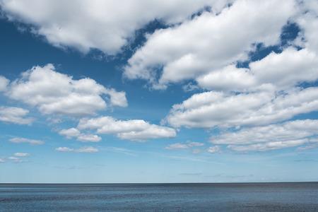 baltic sea: White clouds over still Baltic sea.