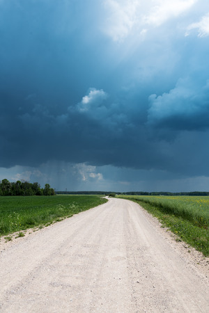 stormy clouds: Stormy clouds over countryside lanscape, Latvia.