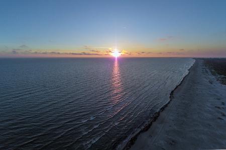 Summer solstice sunset in Baltic sea at latvian coast.