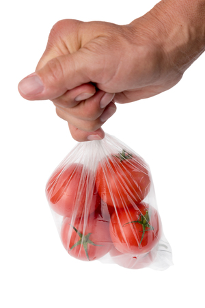 supermarket: Tomatoes in plastic bag.
