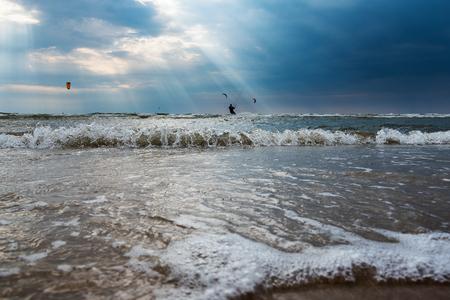 kiteboarding: Sunlight in Baltic sea. Stock Photo