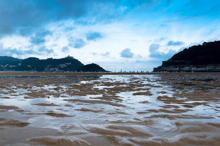 La Concha bay and dark sky, Donostia, Spain.