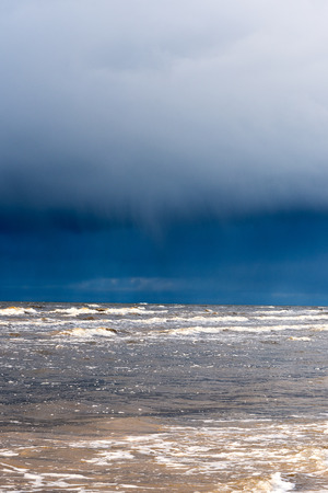Dark clouds over Baltic sea. Stock Photo