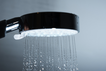 Showerhead and pouring water. Standard-Bild