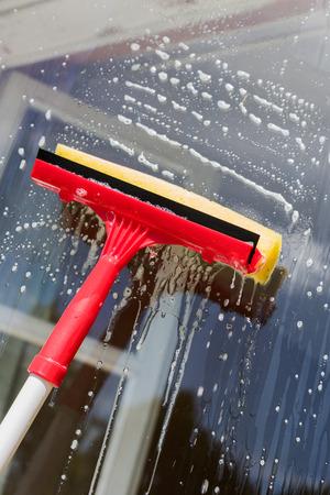 Washing of window.