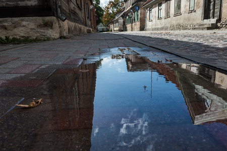 Reflection in puddle .