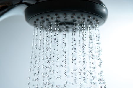 Shower head and falling water drops.