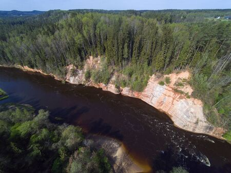 River Gauja and red cliff in spring time, Latvia.