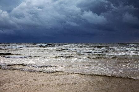 Dark clouds over Baltic sea. Imagens