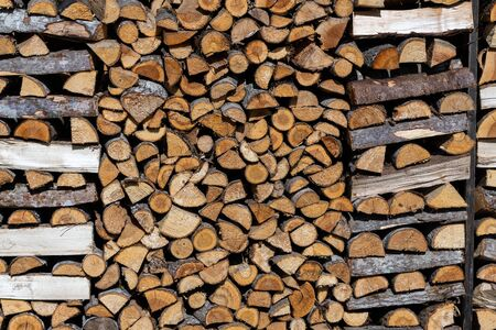 A neatly framed stack of firewood Archivio Fotografico - 131832373