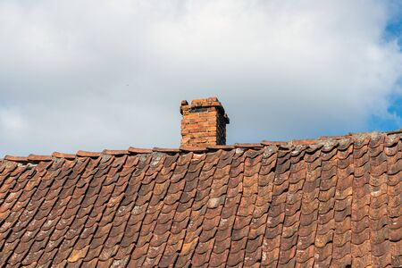 Old clay tile roof and sky.