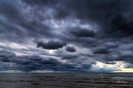 Dark clouds over Baltic sea. Stock fotó