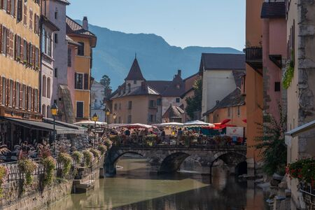 ANNECY, FRANCE - SEPTEMBER 13, 2019 : locals and tourists enjoy shopping in food market in Annecy city center. Editoriali