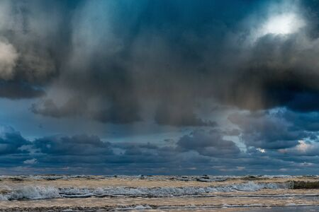 Big clouds over Baltic sea in autumn morning.