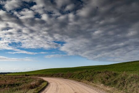 Gravel road in countryside landscape. 스톡 콘텐츠