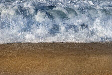 Foamy atlantic wave breaking on coast.