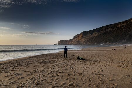 Evening time by Atlantic ocean in Nazare, Portugal.