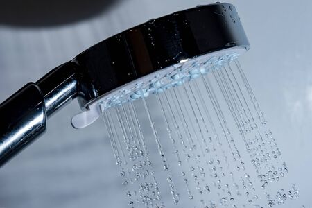Shower head and falling water. Reklamní fotografie