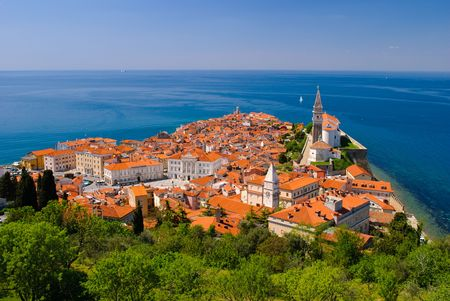 Beatuful Slovenian city by the coast in summer photo