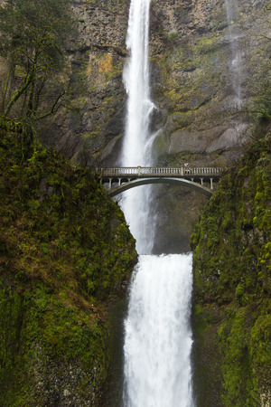 Huge and dramatic waterfall during foggy and rainy day, Multnomah Falls, Oregon
