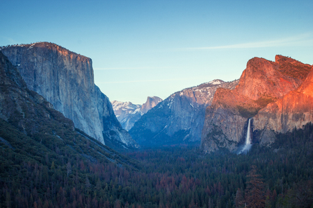 Colorful sunset in Yosemite valley, tunnel view to the dome and El capitan and tall waterfall