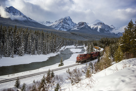 Passing through the river valley under the surveillance of the Rocky Mountains, Rocky Mountains, Morants Curve, Banff National Park, Canada