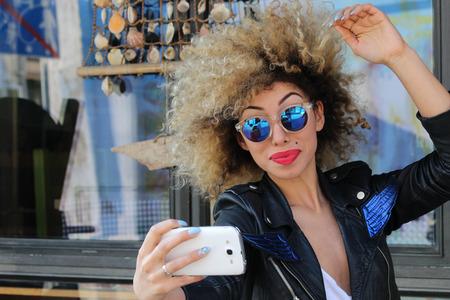 attractive beautiful stylish young girl take selfie