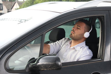 young male driver listening music