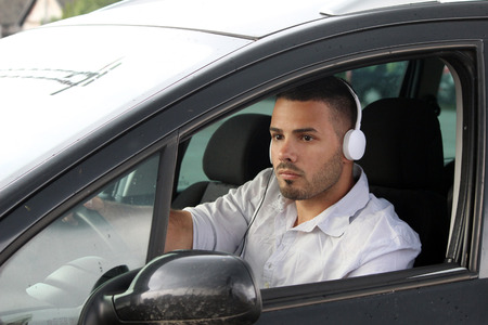 young beautiful man driving a car Stock Photo