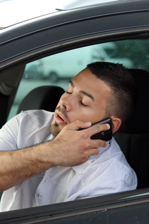 Attention sleepy man driving and speaking at phone