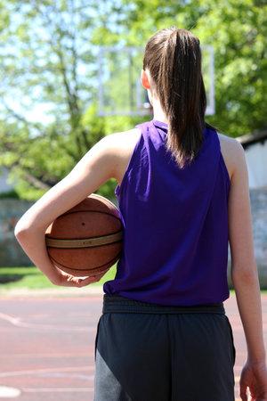 girl player basketball outside