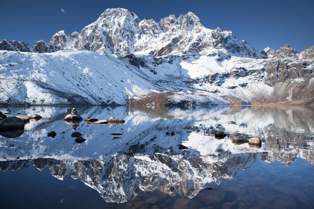 The reflection of snowy mountains are as sharp and bright in the water as they are up in the air.