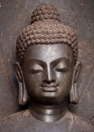 lord buddha: Peace and harmony. The head of Lord Buddha statue. This is an ancient statue which is made of the monolith stone around 7th century. Situated near the Swayambhunath stupa in Kathmandu Nepal. Stock Photo