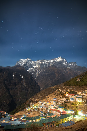 A beautiful village in Himalayas - Namche Bazaar 3,500 m surrounded by mountains and hills in the night.  Banco de Imagens