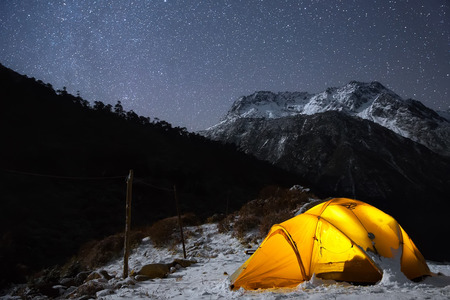 summits: A starry night sky high in the mountains and a tent.