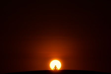 sitting meditation: Meditation. A person is sitting in the Lotus pose in center of the Sun.